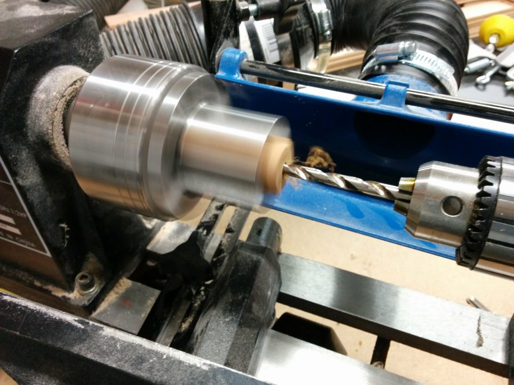 Drilling the hole in the pen blanks.