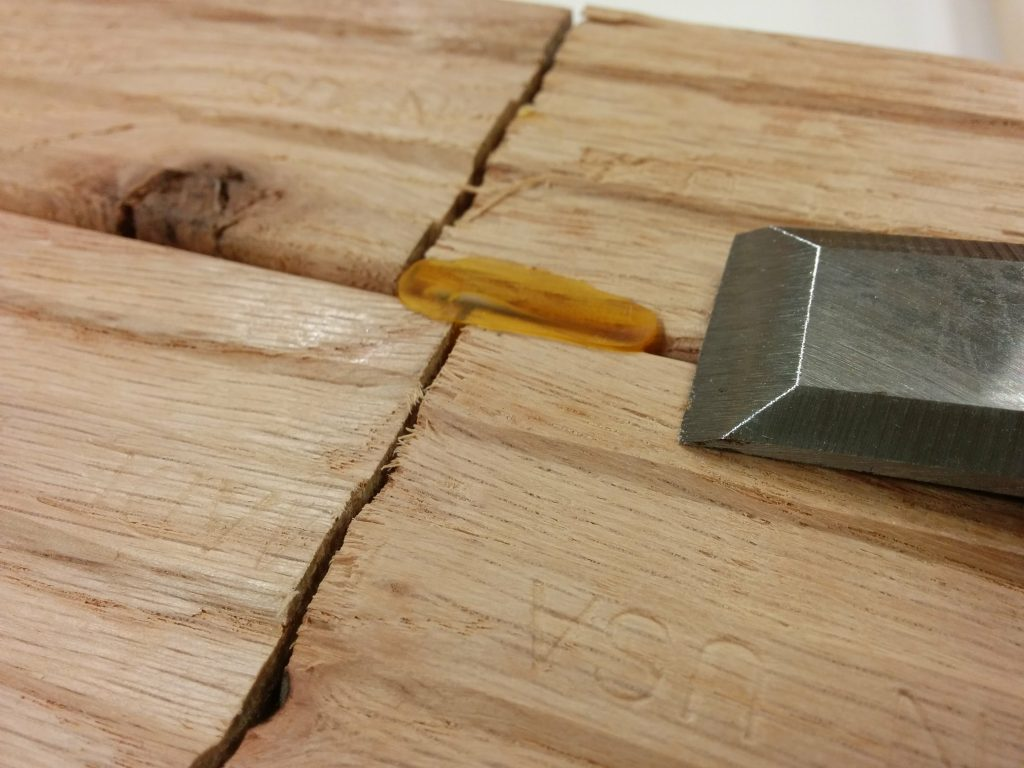 Removing the glue squeeze-out with a chisel.