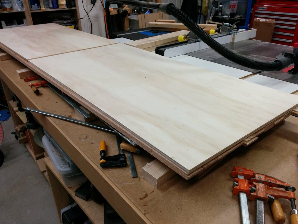 "Laying out the 1/2"" plywood."