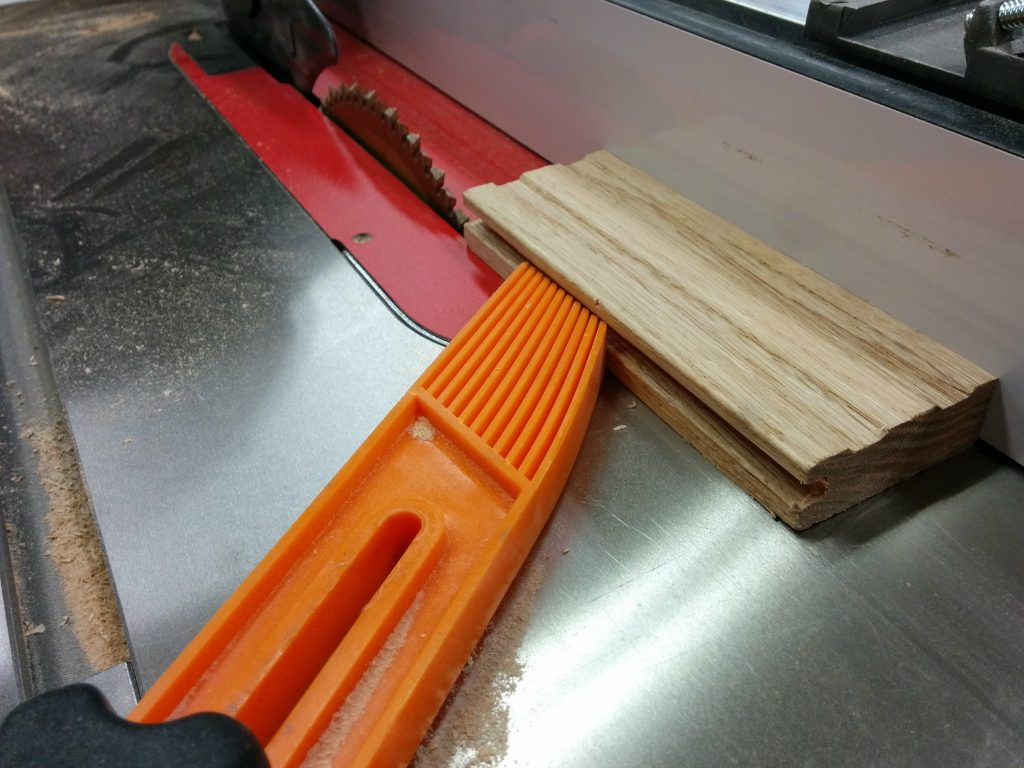 Removing the groove from several pieces of flooring.