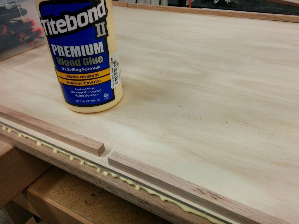 Applied a bead of Titebond 2 to the lip on the underside of the workbench.