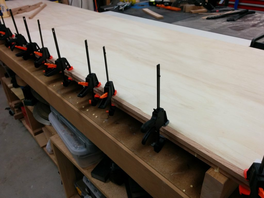Holding the strip in place with some small clamps.