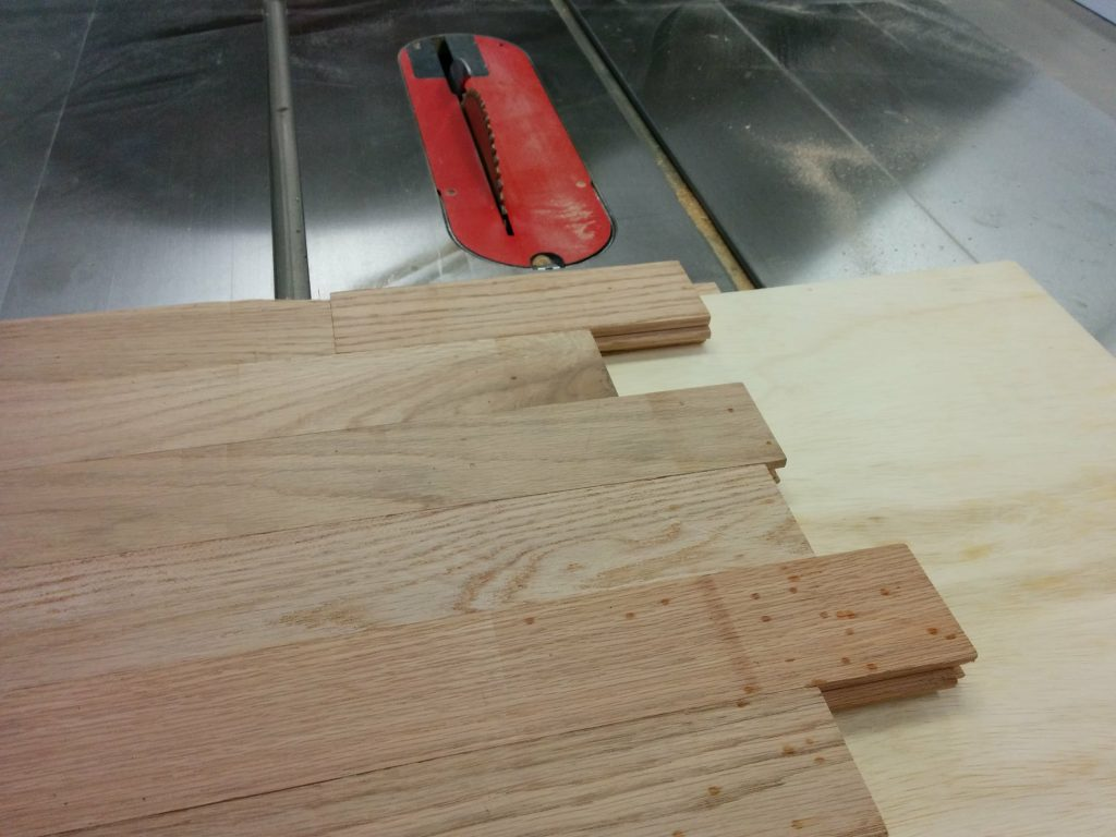 Trimming off the opposite edge at the table saw.