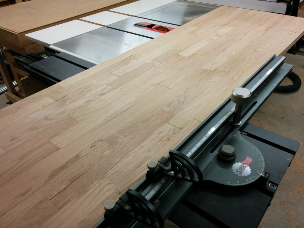 Cutting the benchtop to length using the SawStop sliding crosscut table.