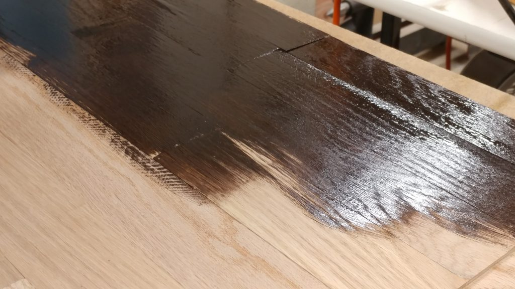 "First I apply the stain with a 3"" brush."