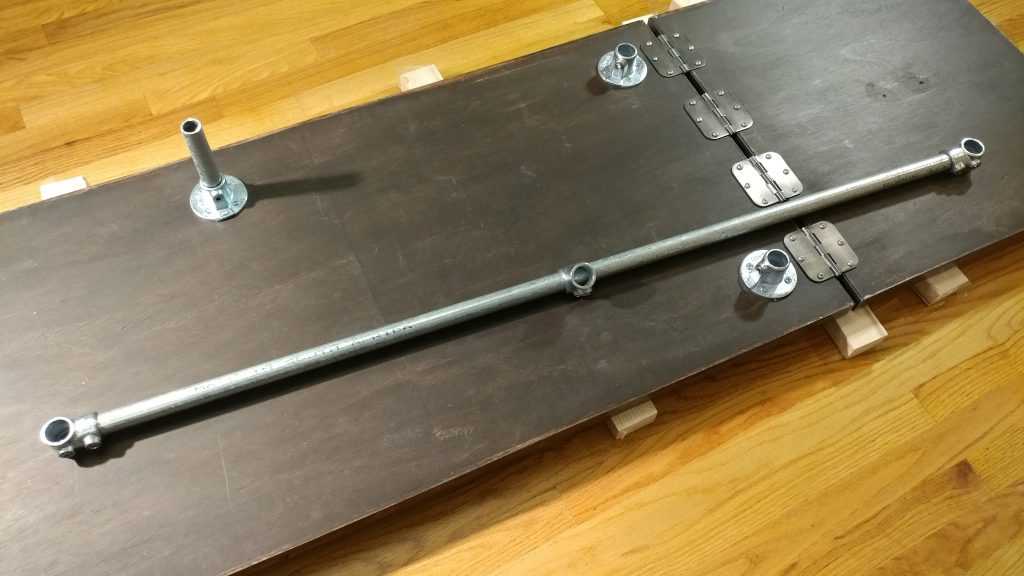 I then created the rear horizontal brace with the longest piece and three of the single socket tees, with the middle one fitting loosely on the bar.