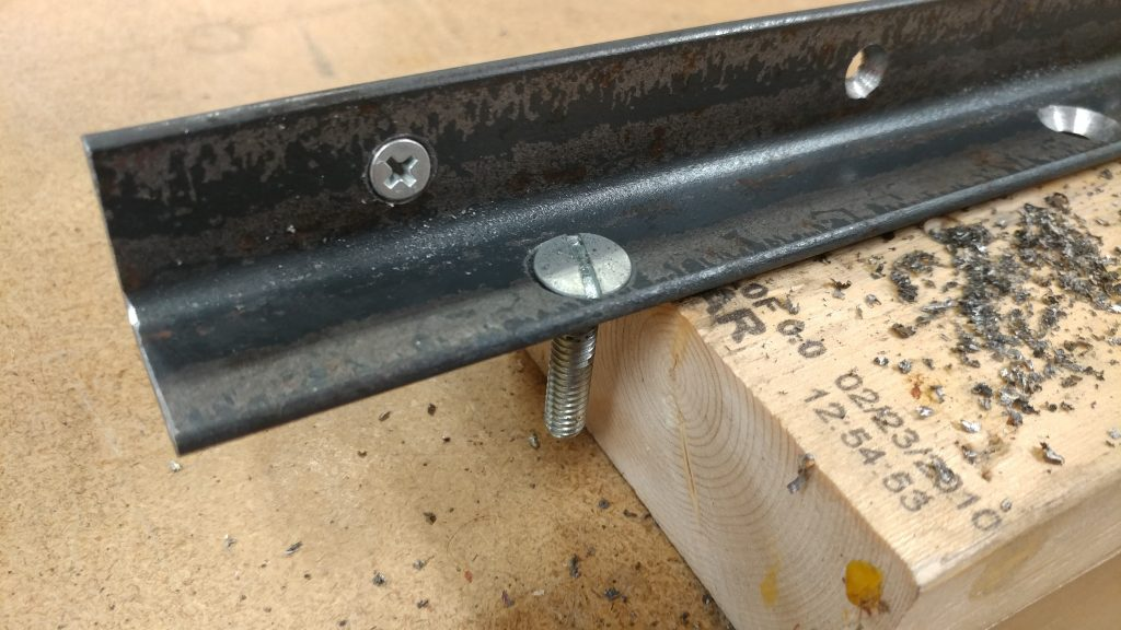 The bolts lay flush with the surface of the angle iron.