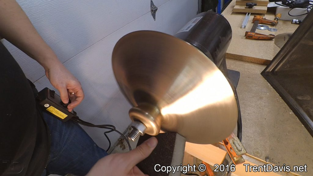 Fig. 12 - Cleaning up the top of the second cymbal with a coarse-grit sanding sponge.