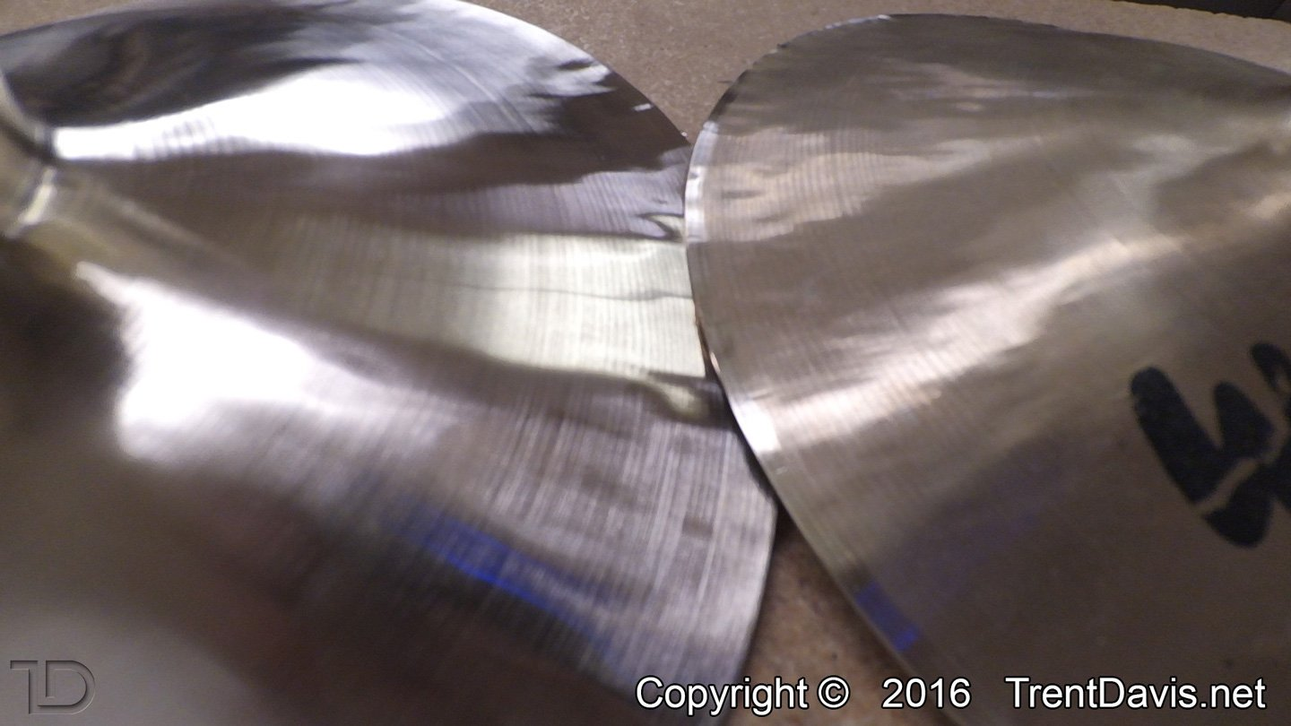 Fig. 16 - A close-up of the two cymbals. The one on the left has been polished up a bit. The one on the right only has the edge de-burred which actually polishes up the area around the edge a bit.