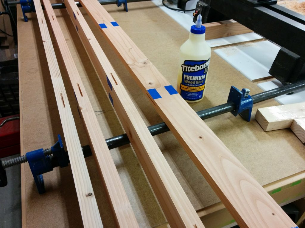 The boards are arranged so that the glue can be applied.