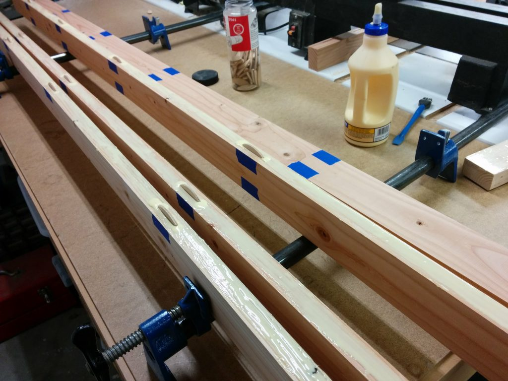 The biscuits are in place after the glue was applied to three of the edges.