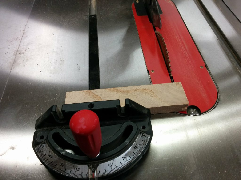 Using the miter gauge to remove the tongues and grooves from the ends.