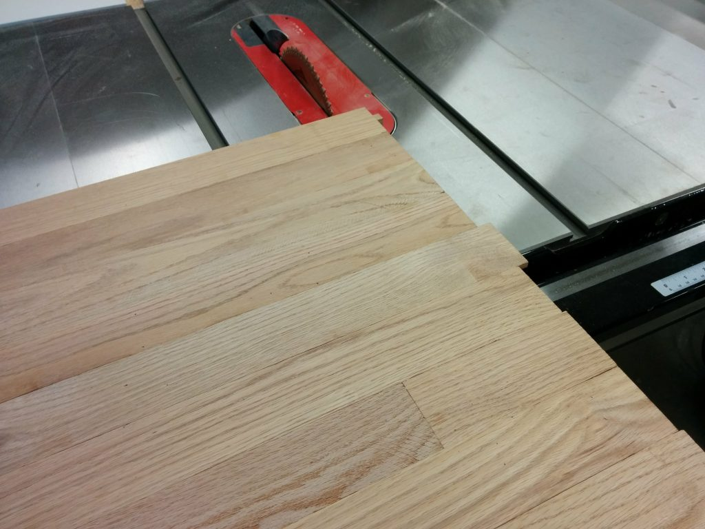 Trimming off the edges of the benchtop at the SawStop table saw using my sliding crosscut table.