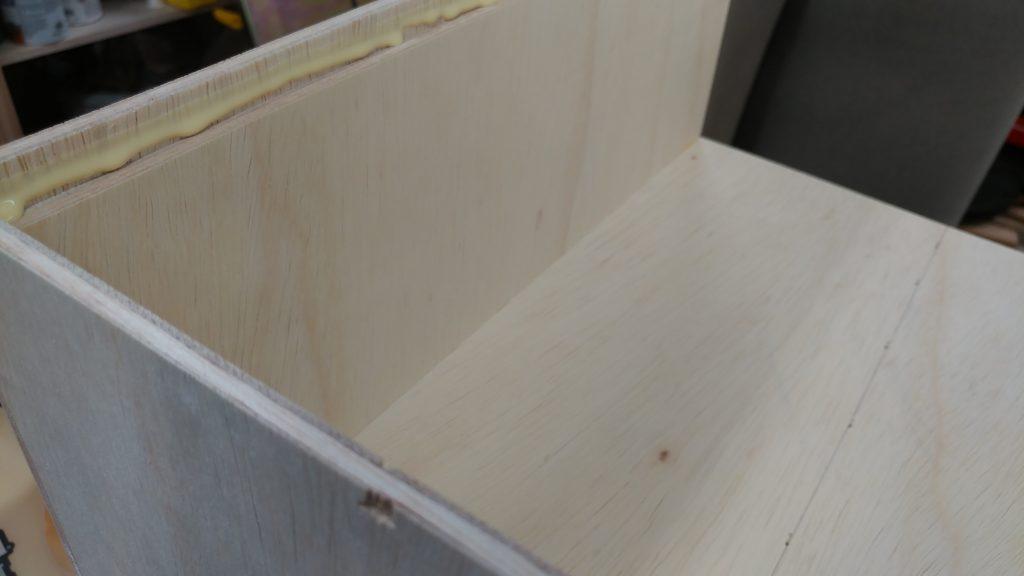 Glue is applied to each rabbet.
