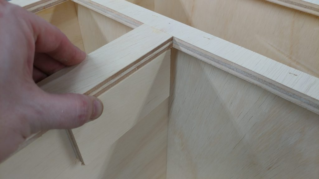 """I used a few scraps of 1/2"""" plywood to center the vertical front piece on the vertical wall."""