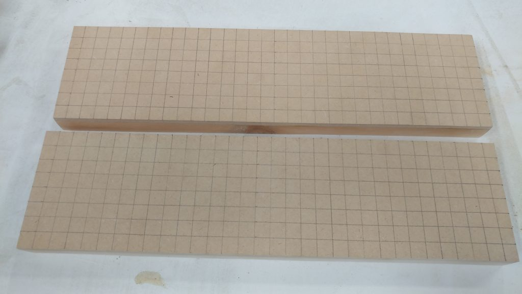 """A 1/2"""" grid drawn on the tops of the drawer bases."""